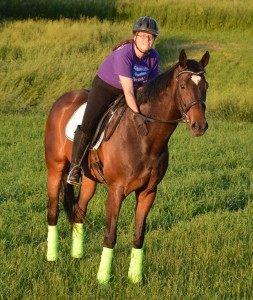 Amy Cone of Bellevue, IA, rides Snapphok, a former racehorse adopted through the Galloping Out program.